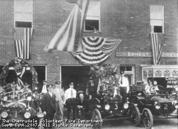 Ernest Shreve ran his business from our firehouse in the 1920's. Firefighters of the era stand outside with their decorated rigs.