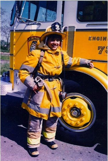 Catie Drew pictured in turnout gear with Engine 73.